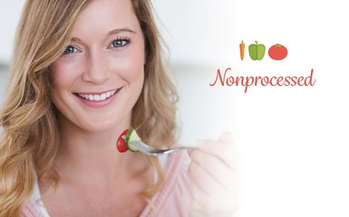 Nonprocessed against closeup of woman having salad
