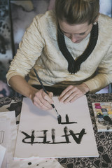 Illustrator drawing sign in studio space