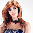 Beautiful woman with long red hairs with blue makeup
