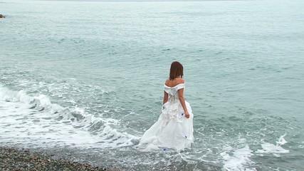 Beautiful Woman In White Dress Walking Into Sea