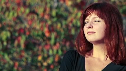 Portrait of Young Brunette Enjoying Sunlight