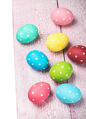 colored Easter eggs on wooden background