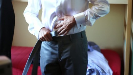 Groom dressing, close up of tie, cuff, shoes and shirt