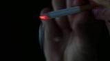 young man smoking cigarette close up