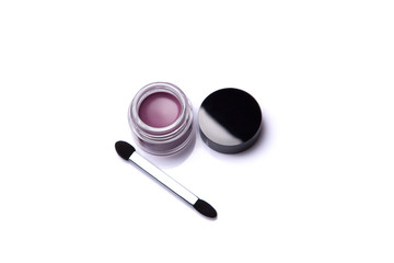 Pink lip gloss in jar with brush