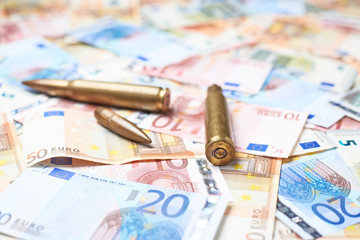 Few bullets over the pile of money
