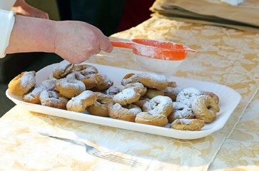 Elder Cook spread the icing sugar over cooked fritters