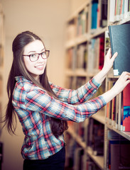 young brunette student at a library