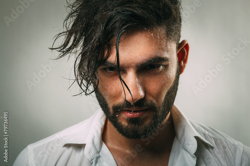 Portrait of a man with a beard and wet face - 79736495