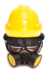 piggy bank wearing gas mask and builders hard hat