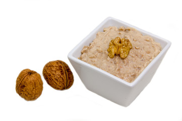 Walnut pesto on bowl on white background
