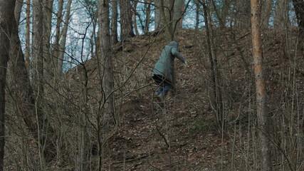 A girl climbing up the hill