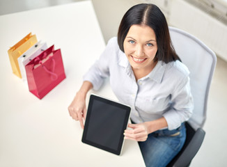 close up of woman with tablet pc at office