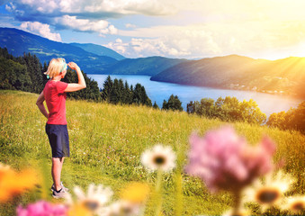girl standing above a lake-sportive holidays 01