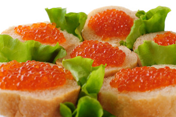 Sandwiches with red caviar and green lettuce.