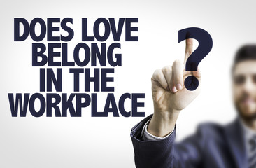 Business man pointing: Does Love Belong in the Workplace?