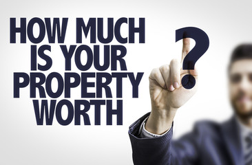 Business man pointing: How Much is your Property Worth?