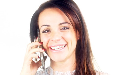 Happy cute young woman talking on the phone