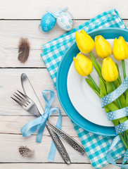 Easter with yellow tulips and colorful eggs