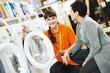 Leinwanddruck Bild - woman shopping at home appliance supermarket