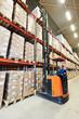 stacker in modern big warehouse - 79739082