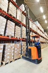 stacker in modern big warehouse