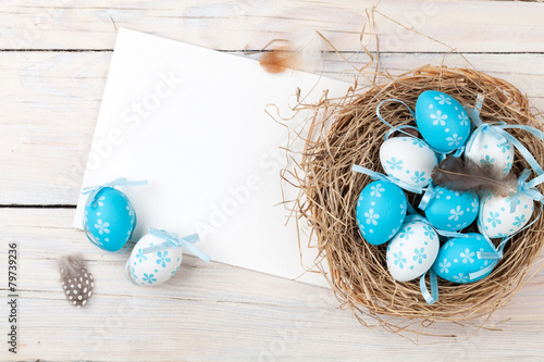 Easter background with blue and white eggs in nest and greeting - 79739236