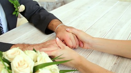 Hands of newlyweds vehemently