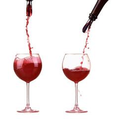 Red winepouring from bottle splash, dispenser on bottle, jet