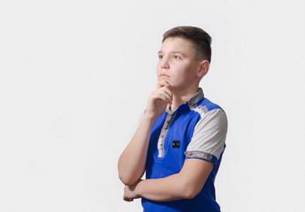 Thoughtful teenager on a white background