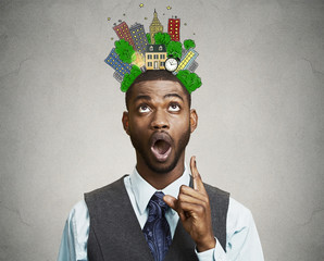 man idea pointing finger looking up city sketched above head