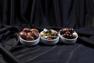 Dark brown dragee, chocolate