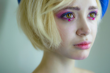 Portrait of young beautiful girl with pink makeup