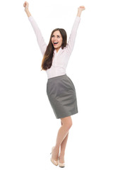 Happy young woman with arms raised