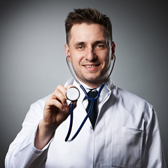 Medical doctor with stethoscope portrait