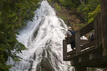 Tourist at Yutaki waterfall in Nikko national park, Japan