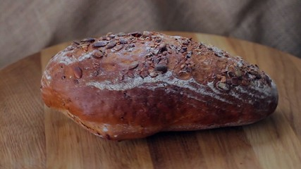 Fresh bread sprinkled with pumpkin seeds.