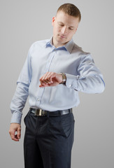 Young businessman with a wristwatch