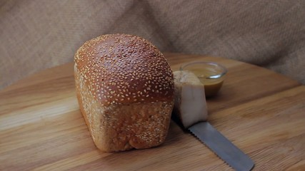 Sesame bread with bacon and mustard