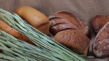 Collection of different sorts of bread on sackcloth