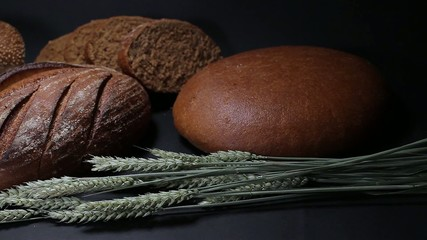Different types of bread on a black background