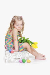 Bored little girl with Easter decorations