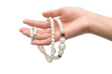 Beautiful pearl necklace on woman hand