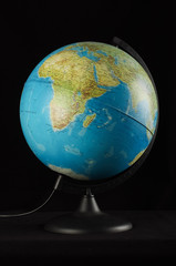 Earth globe isolated on the black background