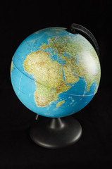 Travel concept. Plastic earth globe model isolated
