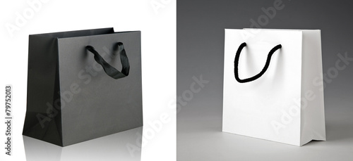 Black and white shopping bags. - 79752013