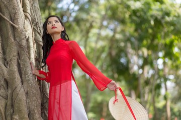 Attractive young Asian woman in traditional dress