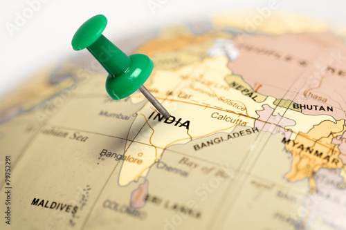 Poster Location India. Green pin on the map.