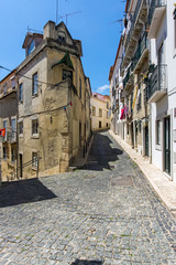 Small alley in the Alfama district in Lisbon, Portugal