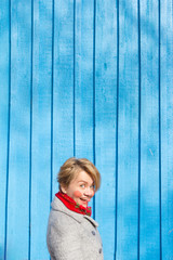 portrait of funny woman on blue wooden wall, saturated color